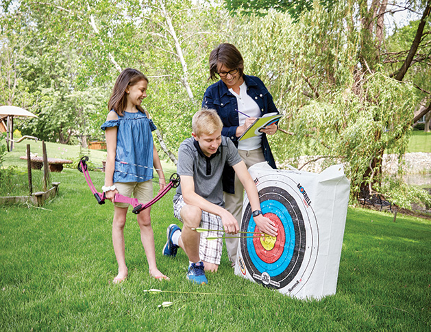 Kim Wilson's kids learn by experiencing, including unique activities like archery.