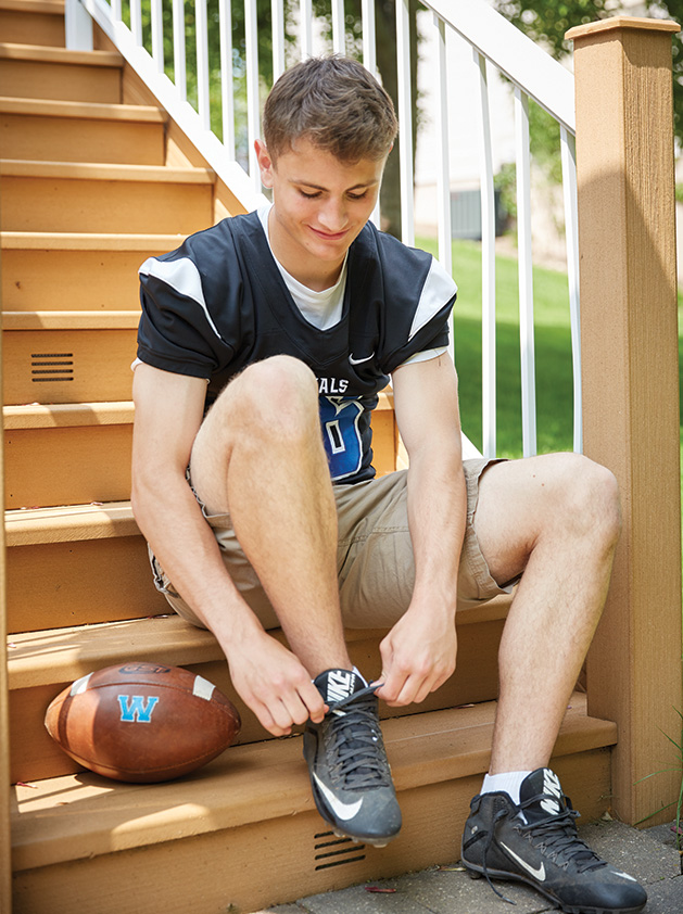 Kim Wilson's high school-aged son participates in football and other activities with traditionally schooled teens.
