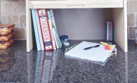 A designated study space set up on a countertop after fall cleaning.