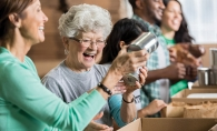 Volunteers pack food kits.