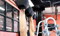 A woman does a chest press while resistance training (lifting weights).