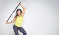 UrbanIRON Fitness owner Dena Smith works out with an exercise band.
