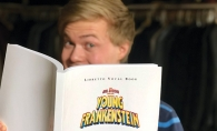 "A member of Woodbury Community Theatre holds the program for ""Young Frankenstein."""