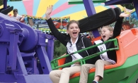 Two kids ride a ride at Woodbury Days.