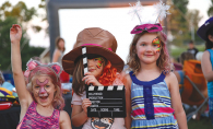 A group of young girls pose for a photo at Starlight Cinema, Woodbury's outdoor summer movie event.