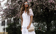 Maria Vizuete, of the blog Mia Mia Mine, poses in a white lace dress