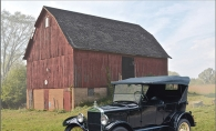 An antique Model T sits in front of the historic Miller Barn in Woodbury.
