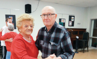 Two seniors dance at an event at DPC Community Center.
