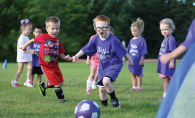 A group of kids play soccer through Woodbury Parks & Recreation, voted Best Place for Kids' Activities in the Best of Woodbury 2019 readers' choice survey.