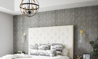 A bedroom with temporary wallpaper on the walls.