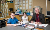 Bill Spencer leads a reading lesson with Caleb Sheehan and Sarah Kershner at Bailey Elementary School.