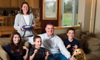Chip and Amy Scoggins at home with their children: Megan , Joe and Spencer and dog Rosie.