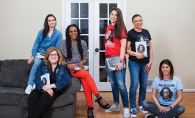 "Sheletta Brundidge of the Two Haute Mamas WCCO Radio podcast poses with her book club, who read Michelle Obama's ""Becoming"""
