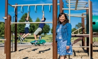 Emily Bowman, publisher of Macaroni Kids SE Metro, MN, plays with her kids at Colby Lake Park