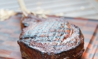 A reverse sear tomahawk steak cooked by Justin Konopaski, aka @cooking_with_justing.