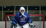 70-year-old goalie Kim Newman stands in net.