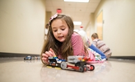 Izzy Drummond builds a Lego creation during a n e2 Young Engineers STEM class.