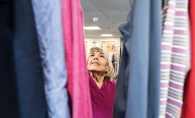 A woman browses the clothing at Woodbury Lutheran Church's Christian Closet.