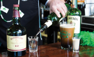 A bartender at O'Malley's Irish Pub, a finalist for best tavern/bar/brewery in the Best of Woodbury 2019 readers' choice survey, pours a shot of Jameson Irish whiskey. A freshly-poured Guiness sits nearby.