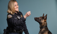 A Woodbury police officer trains a K-9 in the Canine Cadets program.