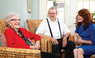 Woodbury Senior Living Columnist Margaret Wachholz sits with two senior residents.
