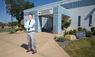 South Washington Alternative High School Principal Nicolas Falde stands in front of the school.