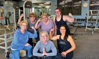 A group of women pose after working out.