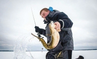 Holding fish caught while ice fishing.