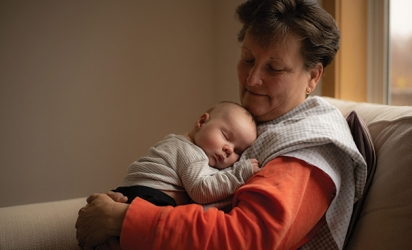 A grandmother holds her grandson in this Focus on Woodbury winning photo