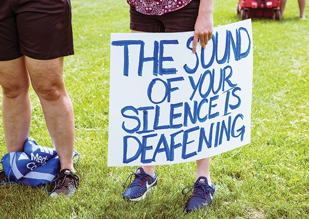 "A sign that reads ""The sound of your silence is deafening."""