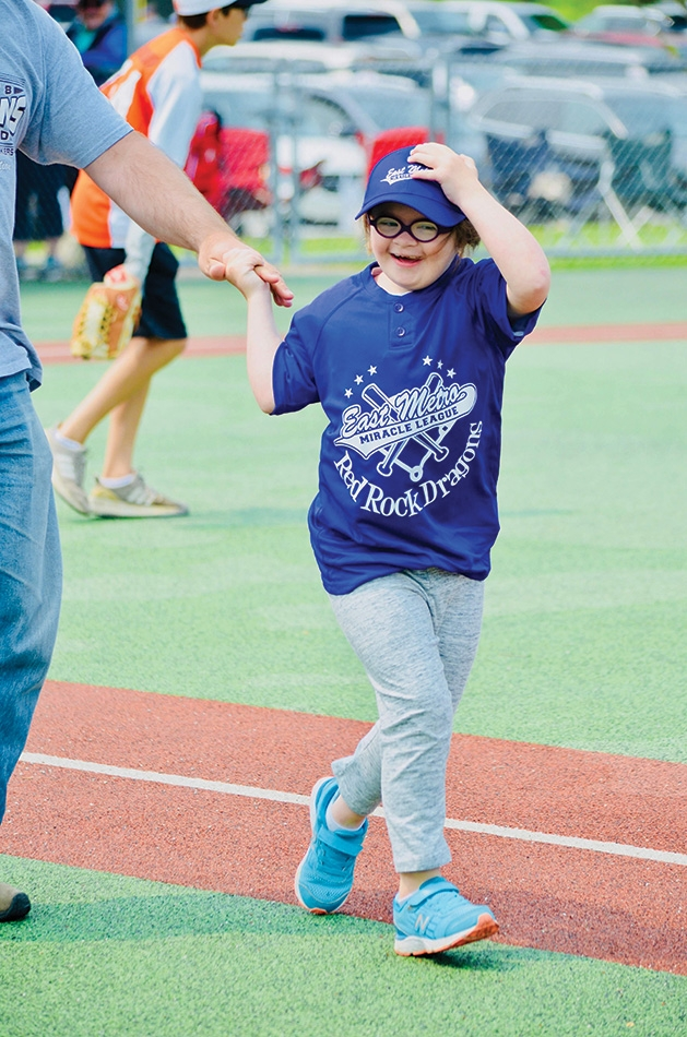 A player runs the bases at an East Metro Miracle League game