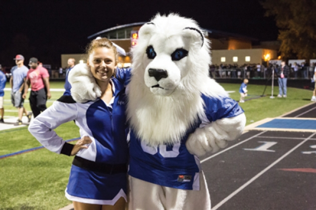 Kylie Johnson and Roar, the mascot