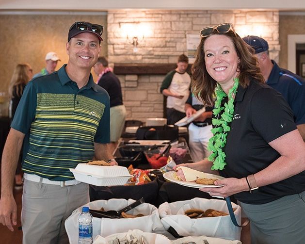 Travis and Tonya Holt at the Woodbury Area Chamber of Commerce golf tournament.