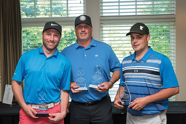 Judd Mann, Todd Polifka and Kris Zuber at the 33rd annual Woodbury Area Chamber of Commerce golf tournament.