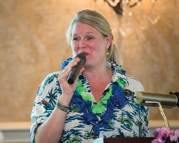 Laurie Staiger speaks at the 33rd annual Woodbury Area Chamber of Commerce golf tournament.