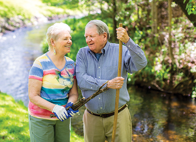 Woodbury residents Genny and Tom Burdette, well-known for their garden and interesting hobbies.