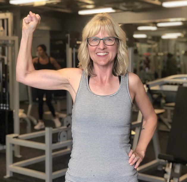 Rhonda Habel flexes at UpLift Guided Fitness in Woodbury