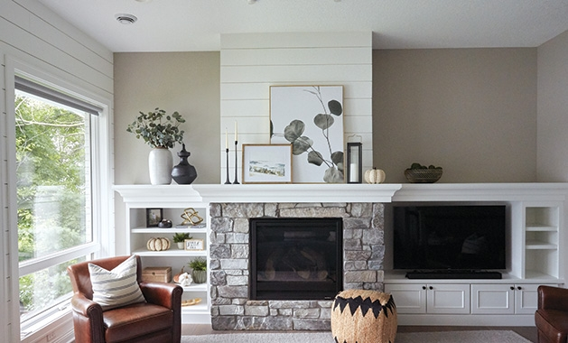 A fireplace decorated by Twigg + Lu in a home designed by Ispiri.
