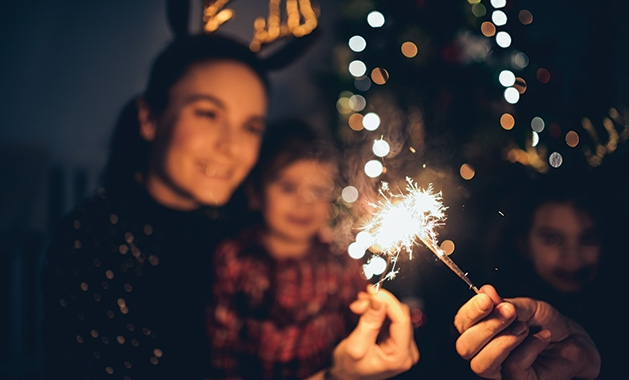 A family celebrates New Year's Eve at home.