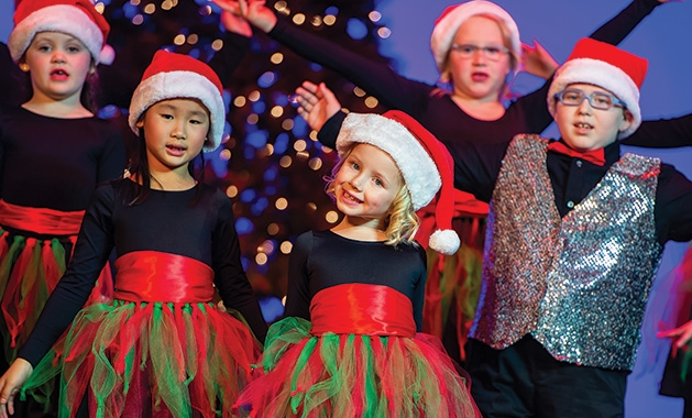 Children sing and dance during Aspire Music Academy's Holiday Spectacular.