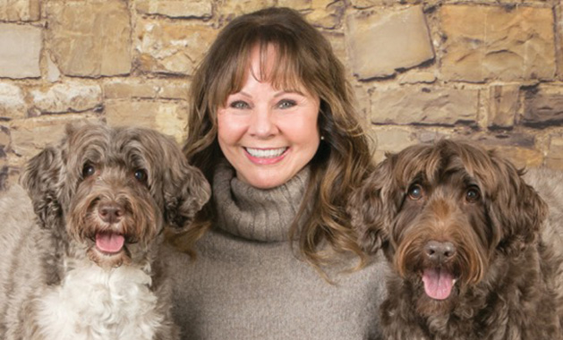 Super Pet Parent Donna Chicone with her two Portuguese water dogs