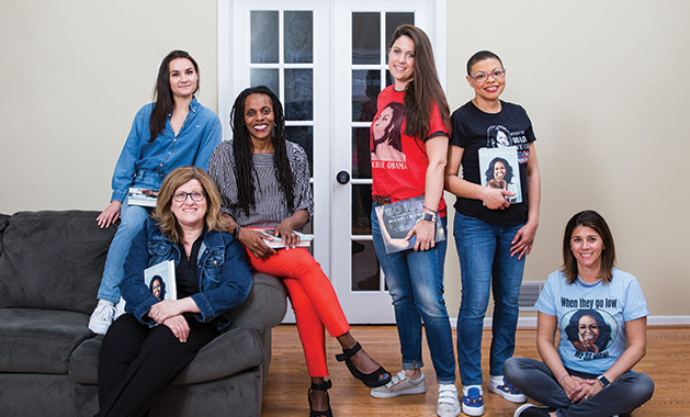 """Sheletta Brundidge of the Two Haute Mamas WCCO Radio podcast poses with her book club, who read Michelle Obama's """"Becoming"""""""