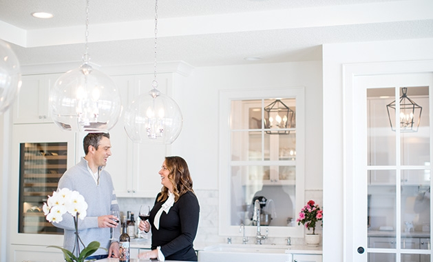 Erin and Darin Rippentrop stand in the kitchen of their Woodbury home, designed and built by Custom One Homes