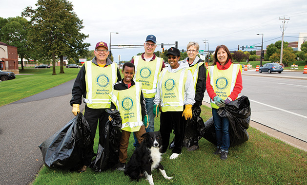 The Woodbury Rotary Club cleans up garbage.