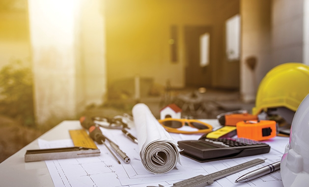 Various home renovation plans and tools like you might find at the Woodbury Home Improvement and Design Expo