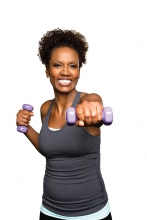 A woman lifts weights.