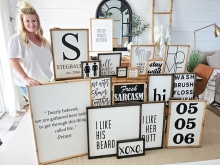 Jessica Stegbauer, owner and creator behind Rusty7s, shows off some of her handmade signs.