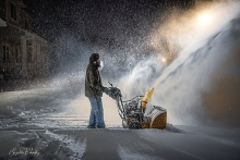 Manjinder Kaur's husband snowblows their Woodbury driveway.
