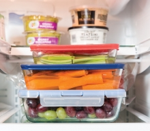 A variety of healthy foods in Tupperware.