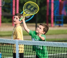 Two children on the court at Little Spikers tennis clinic.